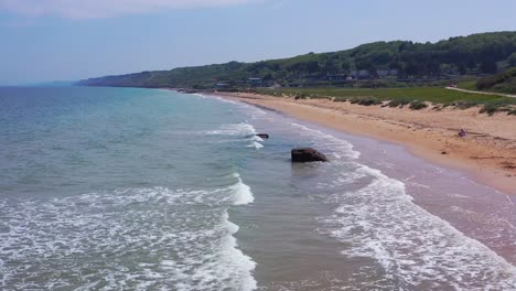 Aerial-over-Omaha-Beach-Normandy-France-site-of-World-War-two-D-Day-allied-invasion-and-Combat-Medics-memorial