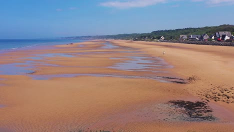 Good-aerial-over-man-running-Omaha-Beach-Normandy-France-site-of-World-War-two-D-Day-allied-invasion