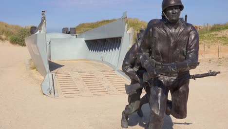 Tilt-up-to-World-War-Two-D-Day-memorial-on-Utah-Beach-Normady-France
