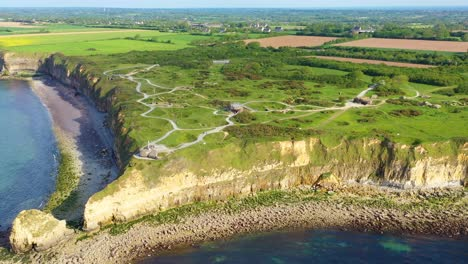 Aerial-over-Pointe-Du-Hoc-Normady-France-D-Day-site-pockmarked-with-bomb-craters