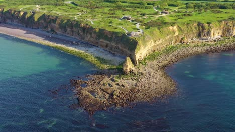 Aerial-over-Pointe-Du-Hoc-Normady-France-D-Day-site-pockmarked-with-bomb-craters-1