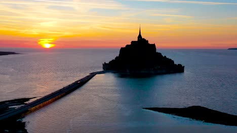 Amazing-aerial-of-Mont-Saint-Michel-France-silhouetted-at-sunset