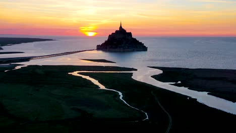 Amazing-aerial-of-Mont-Saint-Michel-France-silhouetted-at-sunset-1