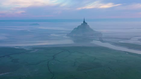 Moody-amazing-aerial-of-Mont-Saint-Michel-France-in-mist-and-fog-in-early-morning