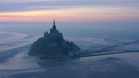 Moody-amazing-aerial-of-Mont-Saint-Michel-France-in-mist-and-fog-in-early-morning-1