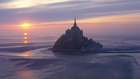 Moody-amazing-aerial-of-Mont-Saint-Michel-France-in-mist-and-fog-in-early-morning-2