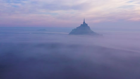 Moody-amazing-aerial-of-Mont-Saint-Michel-France-rising-out-of-the-mist-and-fog-in-early-morning-2