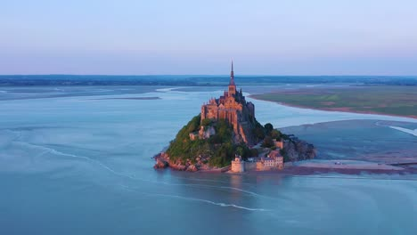 Beautiful-aerial-shot-of-Mont-Saint-Michel-in-Normandy-France-in-sunset-light