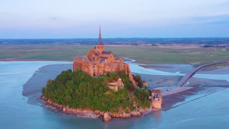 Beautiful-aerial-shot-of-Mont-Saint-Michel-in-Normandy-France-in-sunset-light-1