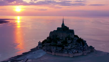 Incredible-aerial-shot-of-Mont-St-Michel-church-in-Normandy-France-silhouetted-against-sunset