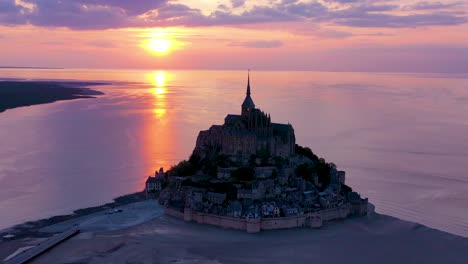 Incredible-aerial-shot-over-Mont-St-Michel-church-in-Normandy-France-silhouetted-against-sunset