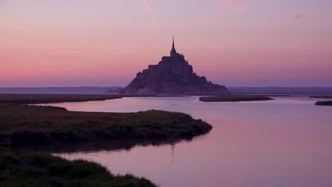 Mont-Saint-Michel-monastery-in-France-in-golden-sunset-light