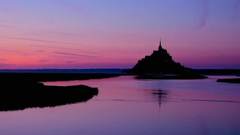Mont-Saint-Michel-monastery-in-France-at-dusk-or-night-in-golden-purple-light-1