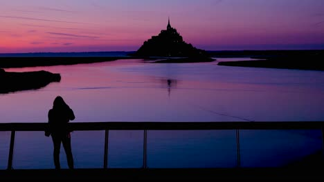 Mont-Saint-Michel-monastery-in-France-at-dusk-or-night-in-golden-purple-light-2