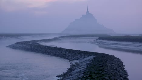 Mont-Saint-Michel-France-rising-out-of-the-mist-and-fog-in-early-morning