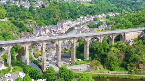 Aerial-over-the-pretty-town-of-Dinan-France-with-highway-bridge