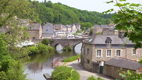 Establishing-the-pretty-town-of-Dinan-France-with-tourists-and-bicycles