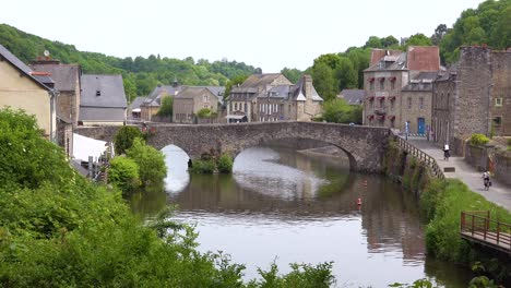 Establishing-the-pretty-town-of-Dinan-France-with-tourists-and-bicycles-1
