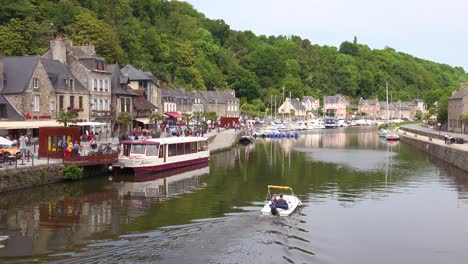 Establishing-the-pretty-town-of-Dinan-France-with-boat-on-Rance-River