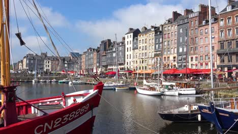 Beautiful-establishing-of-Honfleur-France-with-old-colorful-buildings-and-cafes-2
