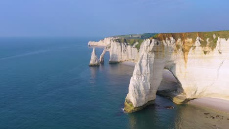 Nice-aerial-around-white-limestone-cliffs-and-arches-at-Etretat-France-English-Channel