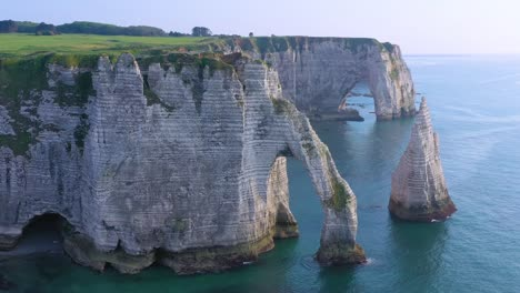 Nice-aerial-around-white-limestone-cliffs-and-arches-at-Etretat-France-English-Channel-3
