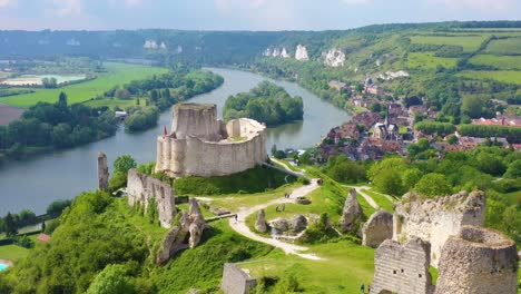Beautiful-aerial-over-a-ruined-fort-or-Chateau-on-a-hilltop-overlooking-the-Seine-River-in-Les-Andelys-France