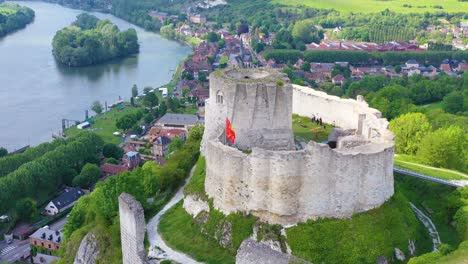 Beautiful-aerial-over-a-ruined-fort-or-Chateau-on-a-hilltop-overlooking-the-Seine-River-in-Les-Andelys-France-1