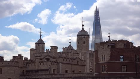 The-Shard-skyscraper-behind-the-Tower-of-London-a-contrast-of-architecture-London-England