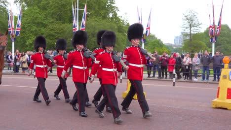 Buckingham-palace-guards-march-through-London-England