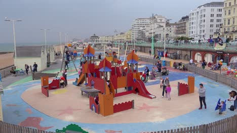 Children-play-on-a-playground-at-the-waterfront-of-Brighton-Beach-United-Kingdom