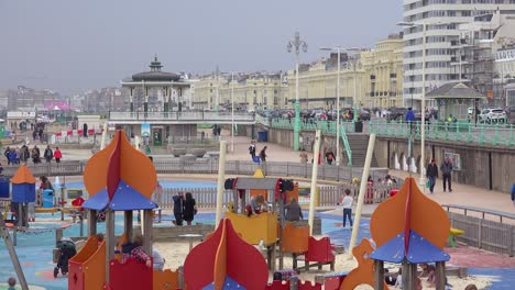Children-play-on-a-playground-at-the-waterfront-of-Brighton-Beach-United-Kingdom-1