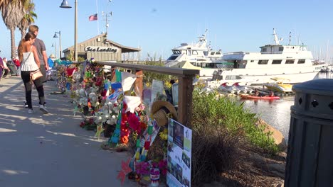 2019---people-pay-respects-at-a-memorial-for-the-Conception-dive-boat-fire-victims-in-Santa-Barbara-harbor-1