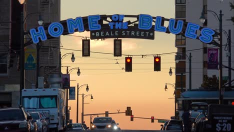 Beautiful-establishing-shot-of-Beale-Street-sign-Memphis-Tennessee-with-trolleys-passing-and-Home-Of-The-Blues-at-dusk