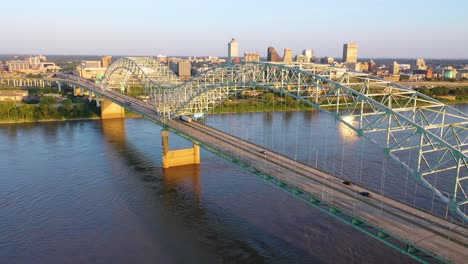 Excellent-rising-aerial-over-the-Hernando-de-Soto-Bridge-reveals-the-city-skyline-and-business-district-of-Memphis-Tennessee