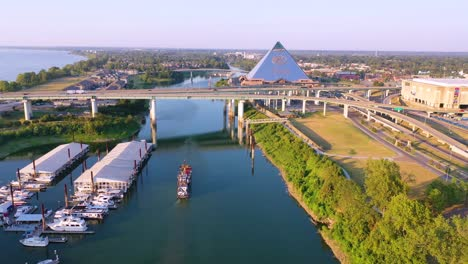 Aerial-over-Memphis-Tennessee-waterfront-and-Mud-Island-with-Memphis-pyramid-background