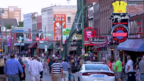Crowds-mill-on-Beale-Street-amidst-bars-clubs-restaurants-and-neon-signs-in-downtown-Memphis-Tennessee