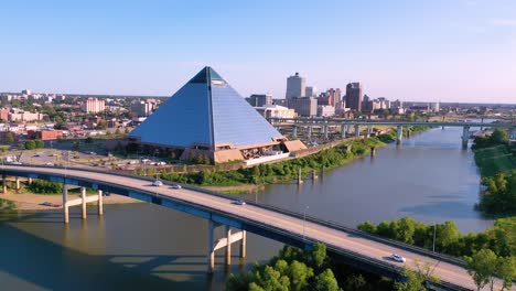 Stationary-aerial-from-Mud-Island-Memphis-Tennessee-with-downtown-skyline-and-Memphis-pyramid-in-distance
