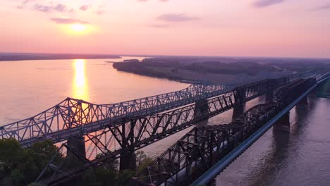 Good-aerial-at-sunset-over-three-bridges-over-the-Mississippi-River-near-Memphis-Tennessee