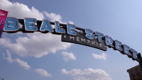 Time-lapse-shot-of-clouds-moving-behind-Beale-Street-Memphis-arch-sign-entertainment-district