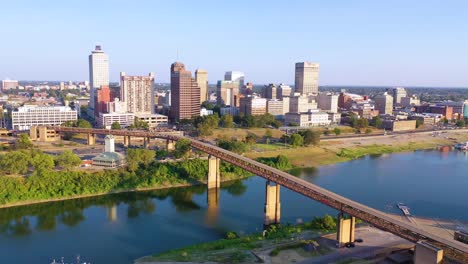 Good-aerial-establishing-shot-of-downtown-city-center-and-business-district-of-Memphis-Tennessee-from-Mud-Island-and-Mississippi-River