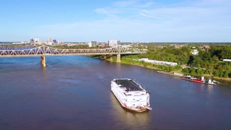 Good-aerial-over-a-Mississippi-River-paddlewheel-steamship-going-under-three-steel-bridges-near-Memphis-Tennessee-2