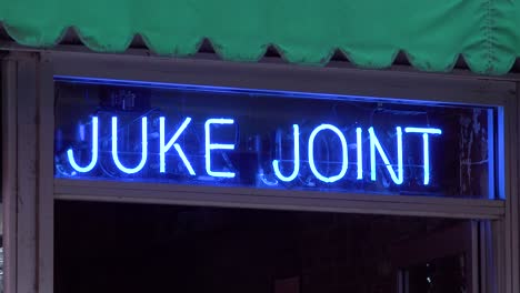 A-neon-sign-on-Beale-Street-Memphis-reads-Juke-Joint-describing-a-honky-tonk-or-blues-music-club