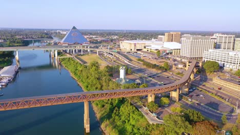 Aerial-over-Memphis-Tennessee-waterfront-and-Mud-Island-with-Memphis-pyramid-background-1