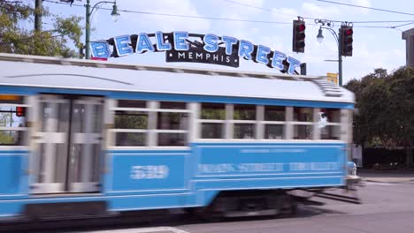 Memphis-trolley-car-on-a-busy-street-outside-Beale-Street-entertainment-district-arch