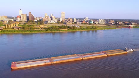 Good-aerial-over-a-barge-on-the-Mississippi-River-with-downtown-business-district-of-Memphis-Tennessee-in-background-1