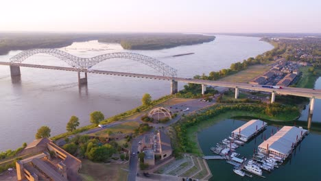 Good-aerial-over-a-barge-on-the-Mississippi-River-with-Hernando-de-Soto-Bridge-foreground
