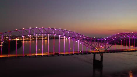 Good-panning-evening-night-aerial-of-Memphis-Hernando-De-Soto-Bridge-with-colorful-lights-cityscape-downtown-and-Mississippi-River