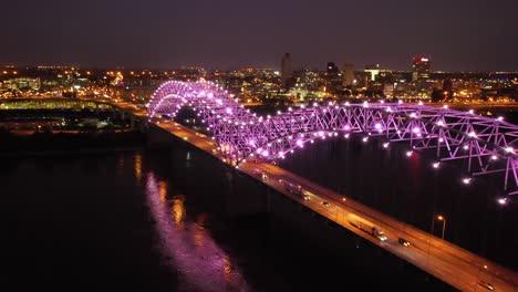 Buenas-Tardes-Noche-Aérea-De-Memphis-Puente-Hernando-De-Soto-Con-Luces-De-Colores-Paisaje-Urbano-En-El-Centro-Y-El-Río-Mississippi