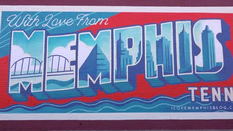 Pretty-postcard-style-mural-on-a-Memphis-Tennessee-building-reads-With-Love-From-Memphis